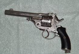 silver and black revolver pistol